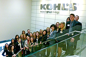 Group of students on a staircase at Kohl's corporate office in New York